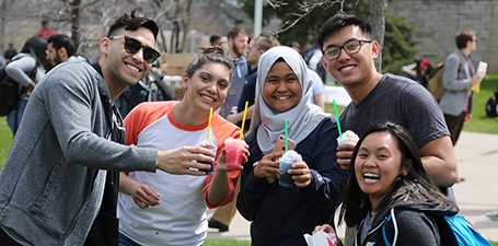 Students holding smoothies in Centennial Mall at student event