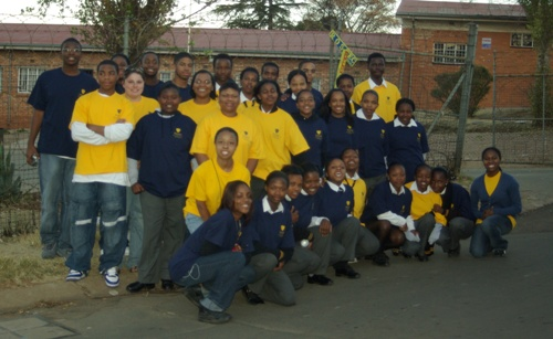 TOLEDO EXCEL students with South African students outside Orlando West High School in Soweto