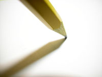 pencil tip touching a piece of paper